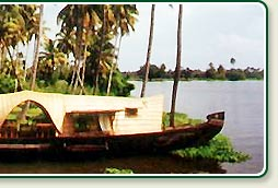 Houseboat on Palm fringed Kerala backwaters